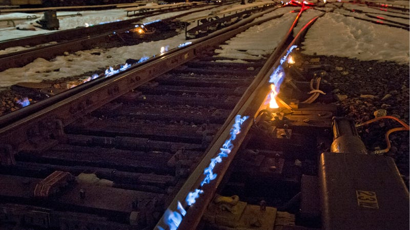 Illustration for article titled This Is The Awesome Way Railroads Keep Tracks Warm In Winter