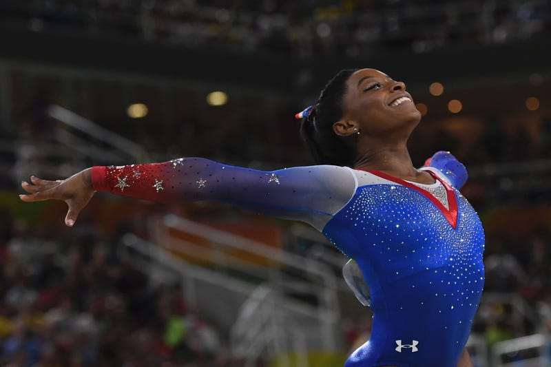 Gymnast Simone Biles competes in the women's floor event final of the Artistic Gymnastics at the Olympic Arena during the Rio 2016 Olympic Games in Rio de Janeiro on Aug. 16, 2016.TOSHIFUMI KITAMURA/AFP/Getty Images