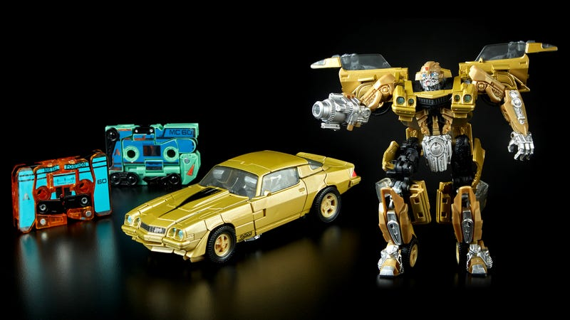 Illustration for article titled Transforming Dino-Cassettes Join a Retro '80s Bumblebee For This Comic-Con Exclusive