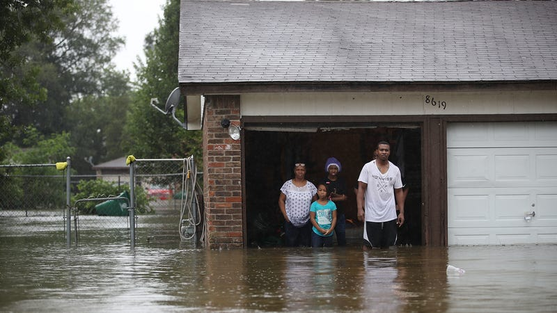 People wait to be rescued from their flooded home after Hurricane Harvey.