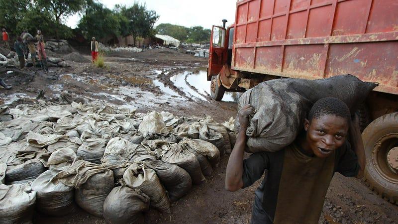A man carries unrefined cobalt near a mine in the southeastern Democratic Republic of Congo