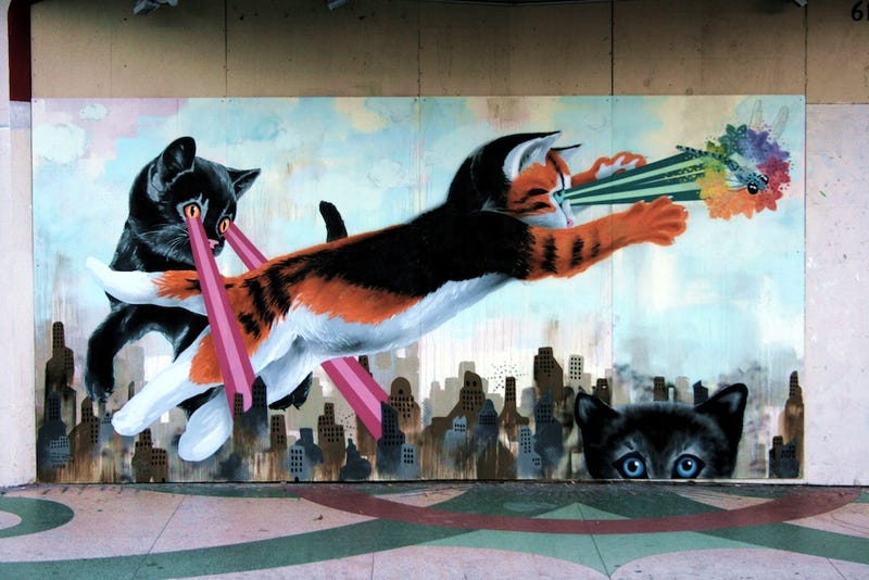 Illustration for article titled Every Single Mural in the World Should Be of Colossal Cats Shooting Lasers
