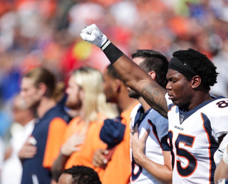 Virgil Green of the Denver Broncos raises his fist during the national anthem before an NFL game against the Buffalo Bills at New Era Field in Orchard Park, N.Y., on Sept. 24, 2017. (Brett Carlsen/Getty Images)
