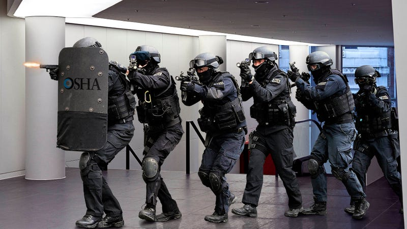 Illustration for article titled OSHA Special Ops Team Raids Local Office After Receiving Intel On Expired Fire Extinguisher