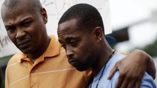 Michael Brown's cousin Eric Davis and Louis Head, Brown's stepfather,attend a news conference Aug. 15, 2014, in Ferguson, Mo. Joshua LOTT/AFP/Getty Images