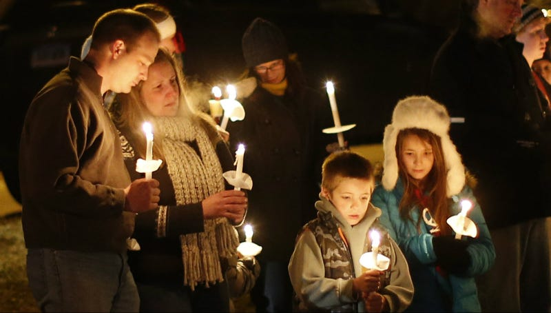 Mourners at a vigil after Sandy Hook, December 2012. Photo via AP