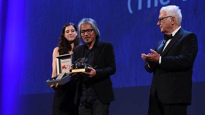 Film director Lav Diaz receives the Golden Lion for Best Film at last year's Venice Film Festival / Image via Getty