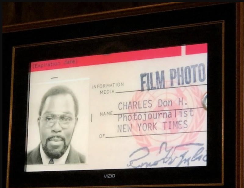 Don Hogan Charles' photo ID was part of a slide show at his funeral. (Marilynn K. Yee)