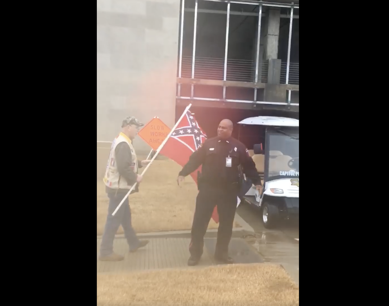 Capitol Police Officer, Greatest of All Time, Wardell Jackson stopping Confederate-flag wavers in front of the Mississippi State Museum (Chris Blount via Facebook)