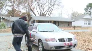 Reshod Johnson surveys the damage done to his car.THV11 screenshot