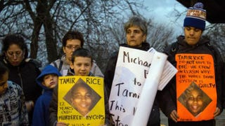 People display signs during a rally Nov. 24, 2014, at Cudell Commons Park in Cleveland for Tamir Rice, a 12-year-old boy fatally shot by police in the park Nov. 22, 2014. JORDAN GONZALEZ/AFP/Getty Images