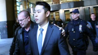 New York City Police Officer Peter Liang is escorted out of court after he was charged with manslaughter, official misconduct and other offenses on Feb. 11, 2015, in the Brooklyn borough of New York City.Spencer Platt/Getty Images