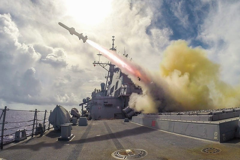 Illustration for article titled A US Navy guided-missile destroyer fires a Harpoon missile in this bad ass photo