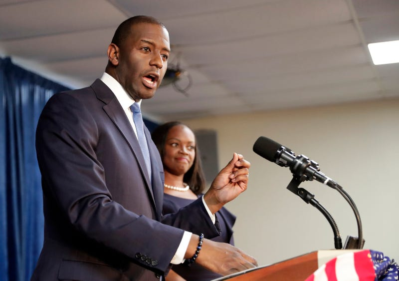 Florida Democratic gubernatorial candidate Andrew Gillum, left, speaks to supporters as his wife R. Jai Gillum listens during a Democratic Party rally Friday, Aug. 31, 2018, in Orlando, Fla.