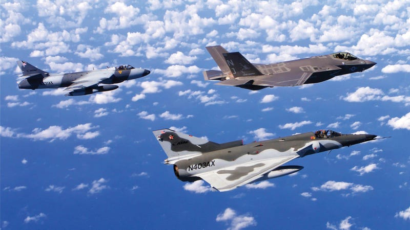 ATAC Hawker Hunter and Kfir fighter jets flying in formation with a US Navy F-35C.