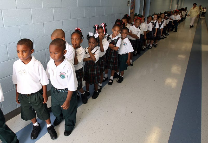 Kindergartners line up on their first day of school at Dr. Martin Luther King Jr. Charter School for Science and Technology in the Lower 9th Ward on Aug. 20, 2007. (Mario Tama/Getty Images)
