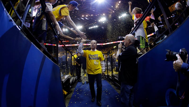 Young fans give high-fives to their idol, the star of the Golden State Warriors, Joe Lacob. (Photo credit: Marcio Jose Sanchez/AP)