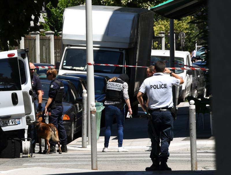 French police officers stand next to a truck in a street in the city of Nice on July 15, 2016, near the building where a man who drove a truck into a crowd watching a fireworks display the day before reportedly lived.ANNE-CHRISTINE POUJOULAT/AFP/Getty Images