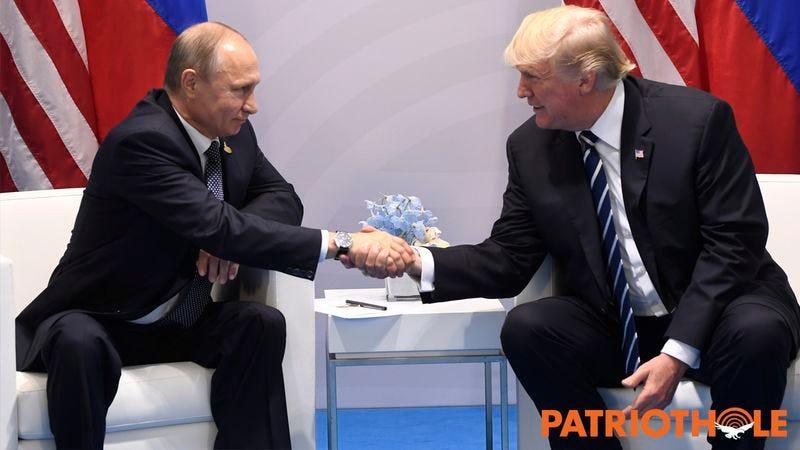 Trump and Putin shaking hands.