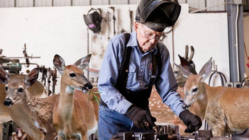 A man who lives in a workshop full of deer.