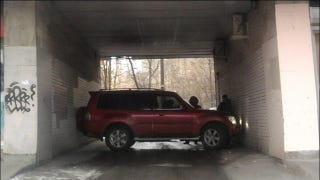 Illustration for article titled How did this Russian SUV end up parked like this?