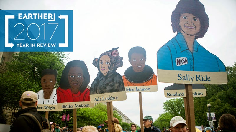 Signs depicting women of color scientists at the March for Science in April. Photo: Getty