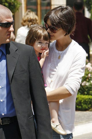 Illustration for article titled Steely Security Guy Scares Little Suri Cruise