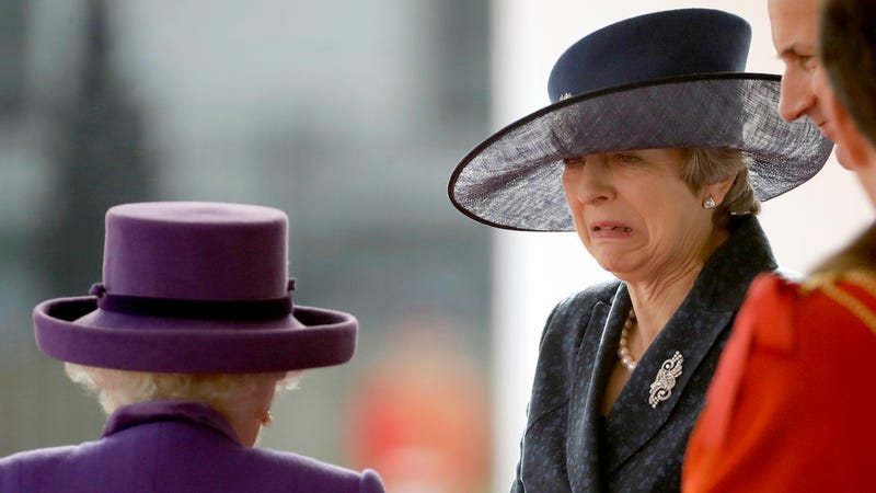 British Prime Minister Theresa May reacts to the Queen in October of 2018