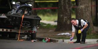 Police investigate a crime scene Saturday where seven people were shot. (Scott Olson/Getty Images)