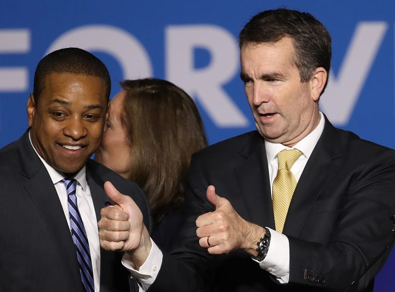Gov.-elect Ralph Northam (R) and Lt. Gov.-elect Justin Fairfax greet supporters at an election night rally November 7, 2017 in Fairfax, Virginia.