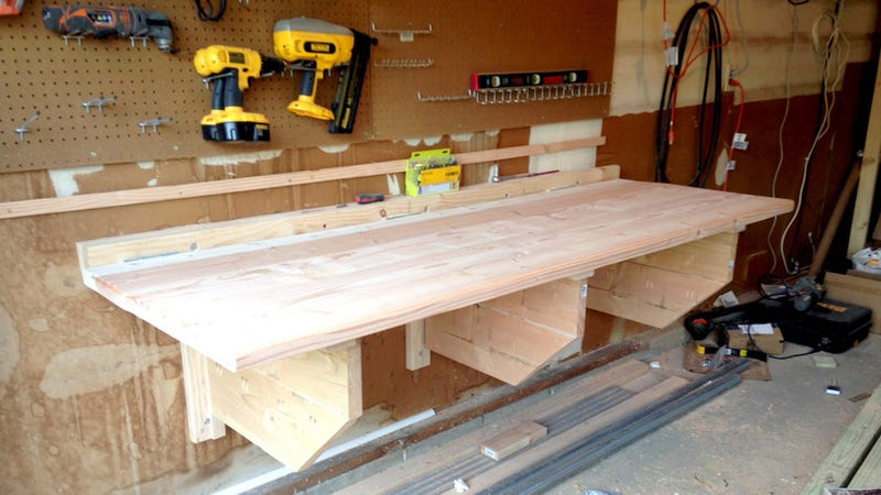 this diy floating workbench folds into place when it 39 s time to work away when you 39 re done. Black Bedroom Furniture Sets. Home Design Ideas