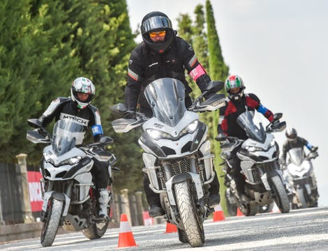 The author tries not to fall off a Ducati Multistrada.