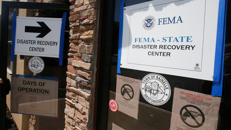 FEMA Disaster Recovery signs direct residents to help in Rainelle, W. Va., in August 2016. A former West Virginia nonprofit director is headed to prison for defrauding FEMA of $18,000 in disaster funds.