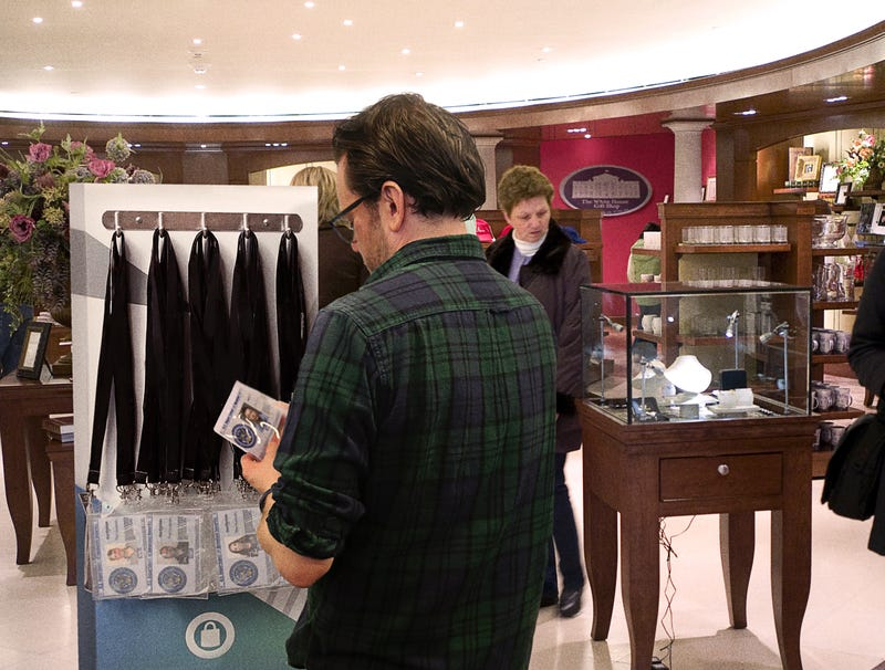 Illustration for article titled Tourist In White House Gift Shop Browses Rack Of Security Clearances