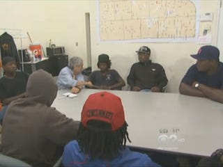 Reporter Walter Jacobson and gang members (CBS News)