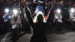 A protester holds up her hands in front of New York police as she and others block traffic on the city's West Side Highway during demonstrations Dec. 4, 2014, against the choke hold death of Eric Garner, a black, unarmed father of six, by a white police officer.TIMOTHY A. CLARY/AFP/Getty Images