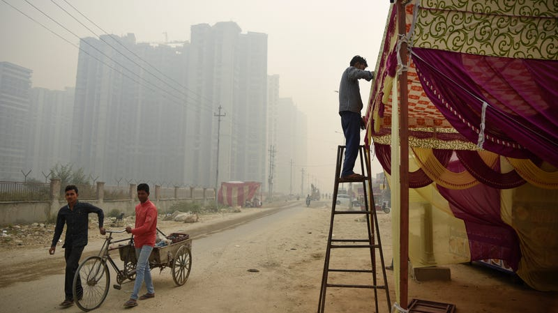Smog-filled skies hover as people prepare for Diwali near New Delhi, India, on November 5, 2018.