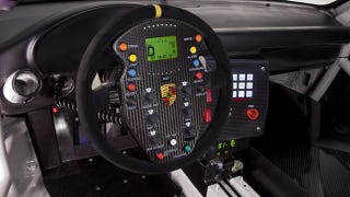 Illustration for article titled The Porsche 911 GT3 R Hybrid's wheel is the world's most insane video game controller