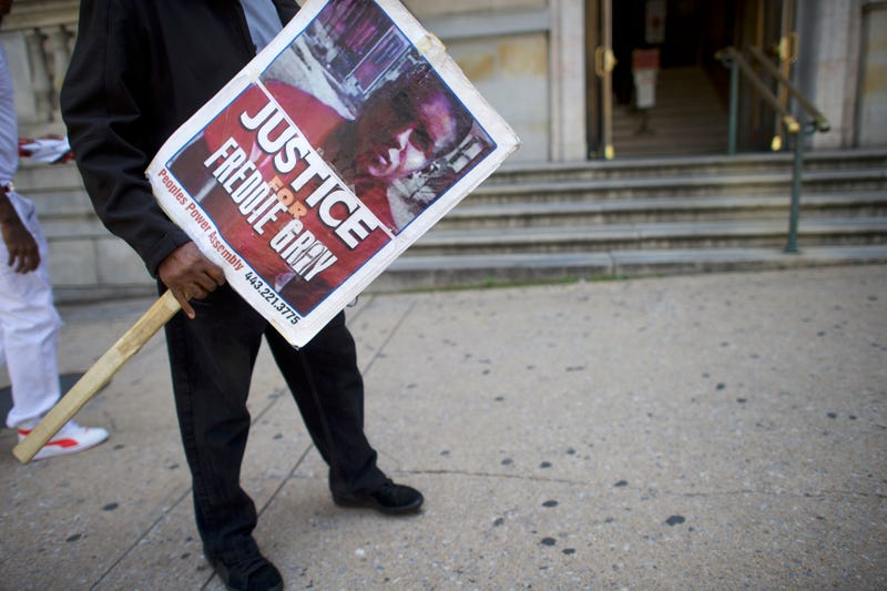 Arthur B. Johnson demonstrates outside Circuit Court in Baltimore on the first day in the trial of Baltimore Police Officer Caesar Goodson Jr. on June 9, 2016. Goodson, the van driver in the Freddie Gray case, is facing multiple charges, including second-degree murder.Mark Makela/Getty Images