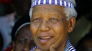 Nelson Mandela, wearing traditional Xhosa dress as a member of the Tembu Royal family, attends the wedding of his great-grandnephew, Prince Mfundo Mtirarar, in 2002 in Umtata, Eastern Cape Province.RAJESH JANTILAL/AFP/Getty Images