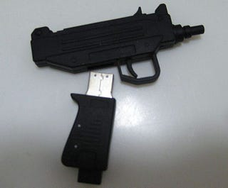 Illustration for article titled Rap Group Hands Out Uzi-Shaped Flash Drive Album