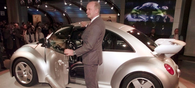 Volkswagen AG chairman, Dr. Ferdinand Piech, poses next to the next generation beetle at the North American International Auto Show in Detroit, Monday, Jan. 4, 1999. AP Photo