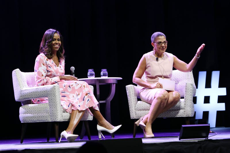 Former first lady Michelle Obama and Women's Foundation of Colorado President Lauren Casteel in Denver on July 25, 2017 (Jason  Bahr/Getty Images for the Women's Foundation of Colorado)