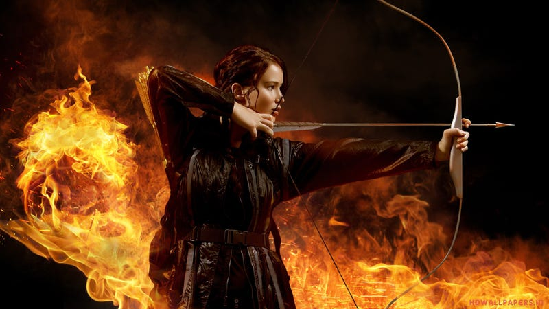 What are the themes in the novel The Hunger Games and how are they shown?