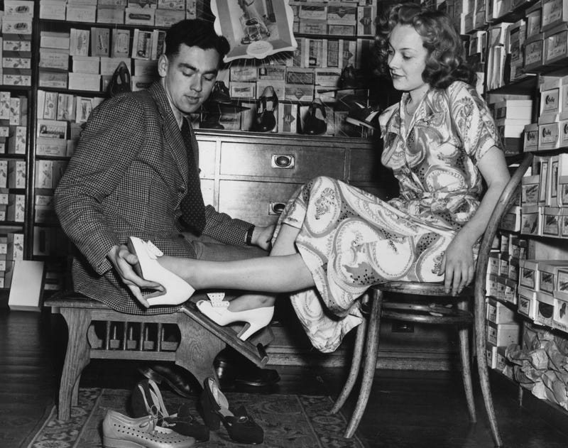 A shoe salesman fits a finalist for the Tonbridge Football Club's 1950 beauty contest. (Photo: Price/Fox Photos/Getty Images)