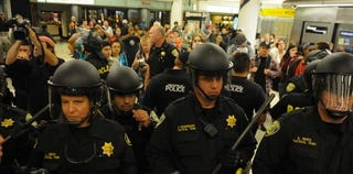 BART riot police engage protesters. (Google)