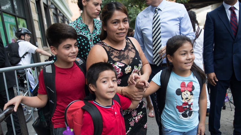 Yeni Gonzalez, center, leaves the Cayuga Centers with her children Lester, 11, from left, Deyuin, 6, and Jemelin, 9, after being reunited with her children, Friday, July 13, 2018, in New York. Gonzalez, who was separated from her three children at the U.S.-Mexico border, was reunited on Tuesday at the social services center.