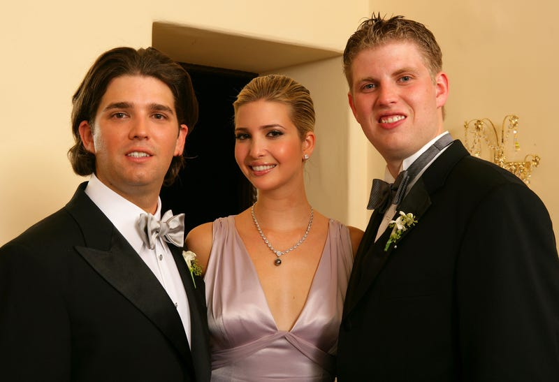 Donald Trump Jr. with his sister Ivanka Trump and brother, Eric Trump, after the wedding ceremony at the Mar-a-Lago Club  in Palm Beach, Fla., on Nov. 12, 2005 (Carlo Allegri/Getty Images)