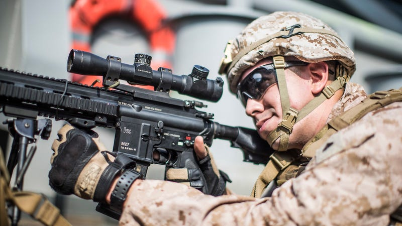 U.S. Marine Corps Corporal Isaiah Ledesma provides security with an M27 rifle aboard the USS Boxer on July 18, 2019 in a photo released by the U.S. military