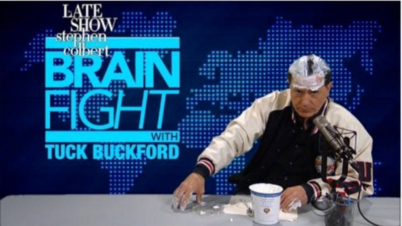 Illustration for article titled Stephen Colbert smears yogurt on his head in ongoing quest to mock Alex Jones